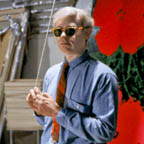 Andy Warhol in 47th street Factory in front of Flowers silk screen, holds a light cord. NYC 1965. Artwork--Factory